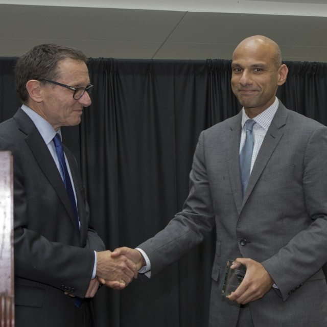 Dean Polonsky and Mustafa Hussain shaking hands